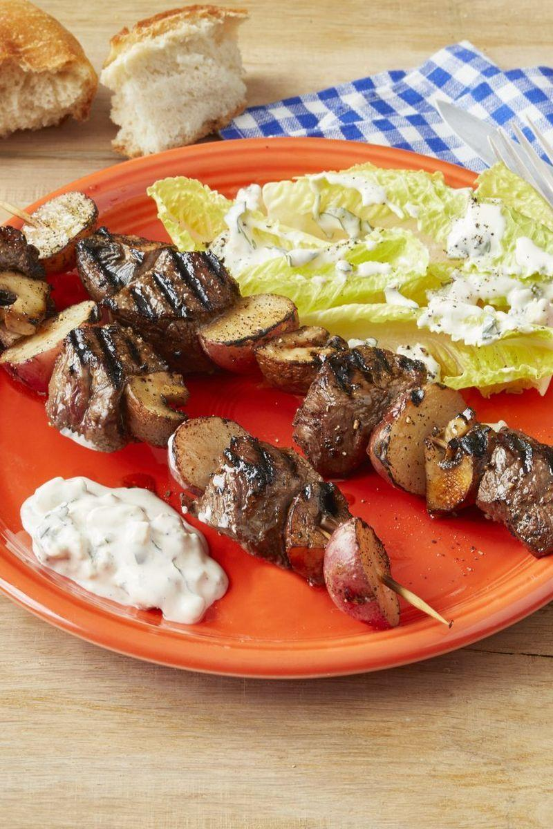 """<p>Serve these steakhouse kebabs as either a main dish or an appetizer! The only requirement? Doling out generous portions of the accompanying blue cheese dressing to each guest.</p><p><strong><a href=""""https://www.thepioneerwoman.com/food-cooking/recipes/a32433429/steakhouse-kebabs-recipe/"""" rel=""""nofollow noopener"""" target=""""_blank"""" data-ylk=""""slk:Get the recipe"""" class=""""link rapid-noclick-resp"""">Get the recipe</a>.</strong></p><p><a class=""""link rapid-noclick-resp"""" href=""""https://go.redirectingat.com?id=74968X1596630&url=https%3A%2F%2Fwww.walmart.com%2Fsearch%2F%3Fcat_id%3D0%26facet%3Dbrand%253AThe%2BPioneer%2BWoman%26query%3Dthe%2Bpioneer%2Bwoman%2Bplates&sref=https%3A%2F%2Fwww.thepioneerwoman.com%2Ffood-cooking%2Fmeals-menus%2Fg32188535%2Fbest-grilling-recipes%2F"""" rel=""""nofollow noopener"""" target=""""_blank"""" data-ylk=""""slk:SHOP PLATES"""">SHOP PLATES</a></p>"""