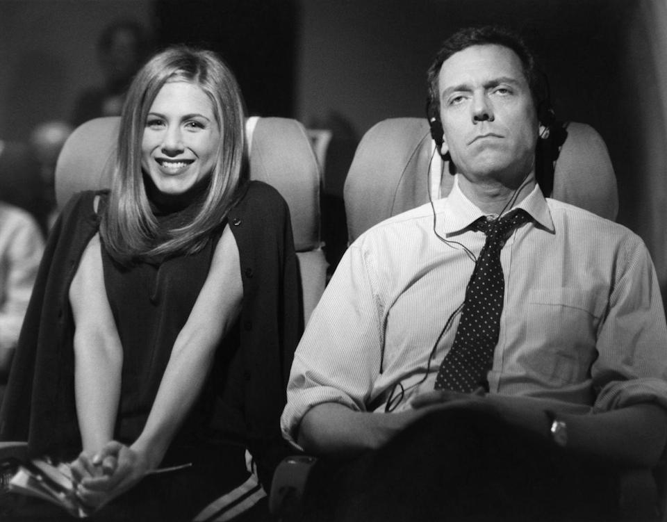 <p>When Rachel decides to fly across the pond for Ross' wedding, she shares the row with British actor, Hugh Laurie, who is less than pleased to be seated next to her.</p>