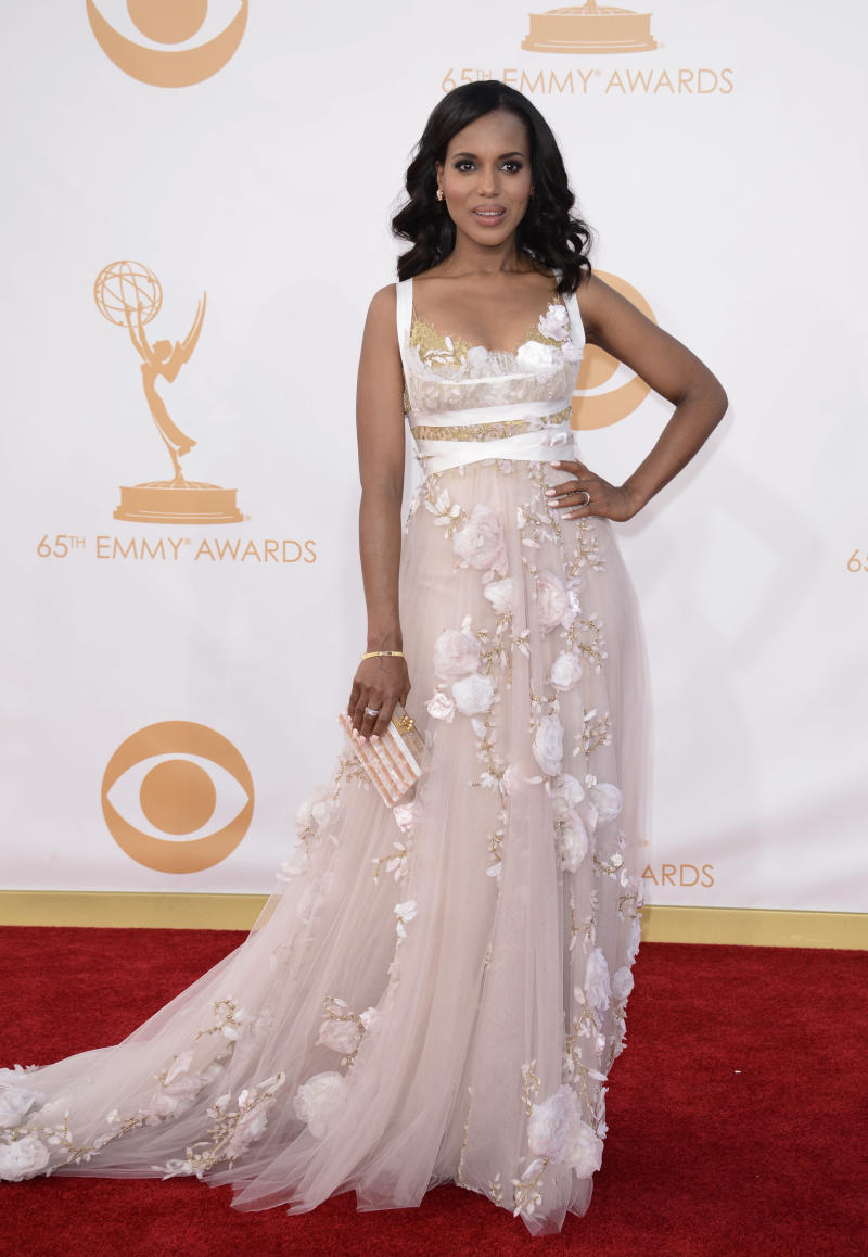 """FILE - This sept. 22, 2013 file photo shows actress Kerry Washington at the 65th Primetime Emmy Awards at Nokia Theatre in Los Angeles. An """"it"""" girl of the Hollywood-fashion nexus becomes even hotter. TV's """"Scandal"""" actress Kerry Washington made glamorous appearances at New York Fashion Week, where she judged """"Project Runway"""" in a pretty Stella McCartney floral number, and at the Emmys, in an eye-catching Marchesa gown. (Photo by Dan Steinberg/Invision/AP, File)"""