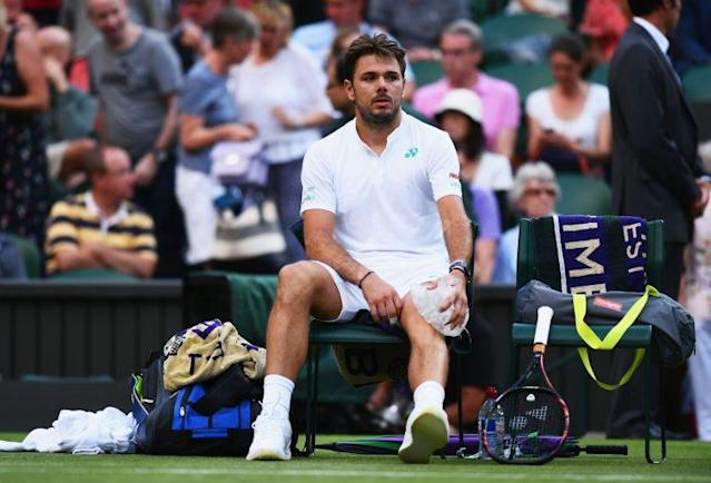 """<a class=""""link rapid-noclick-resp"""" href=""""/olympics/rio-2016/a/1223139/"""" data-ylk=""""slk:Stan Wawrinka"""">Stan Wawrinka</a> battled knee trouble and sloppy play en route to an early exit at Wimbledon. (Getty Images)"""