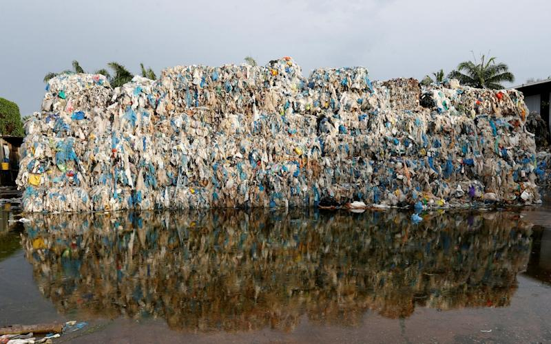 Plastic waste piled outside an illegal recycling factory in Jenjarom, Kuala Langat - REUTERS