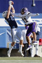 BYU tight end Isaac Rex (83) makes a reception for a touchdown against North Alabama defensive back K.J. Smith (12) in the second quarter during an NCAA college football game Saturday, Nov. 21, 2020, in Provo, Utah. (AP Photo/Jeff Swinger, Pool)