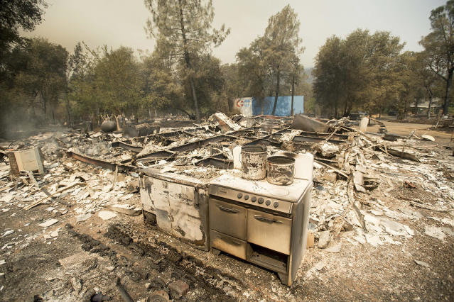 <p>A stove stands in front of a structure leveled by a wildfire near Oroville, Calif., on Saturday, July 8, 2017. Residents were ordered to evacuate from several roads in the rural area as flames climbed tall trees. (AP Photo/Noah Berger) </p>