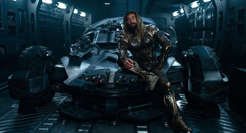 Jason Momoa sits atop the Batmobile in 'Justice League' (Warner Bros.)