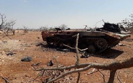 A damaged military tank is seen in Idlib countryside