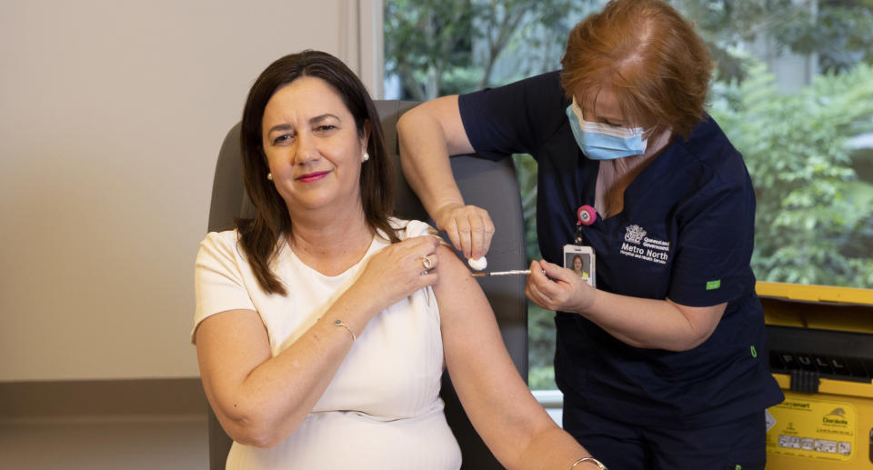 Queensland Premier Annastacia Palaszczuk is given the her Covid-19 vaccination by clinical nurse Dawn Pedder at the Surgical Treatment Rehabilitation Service Centre in Brisbane.