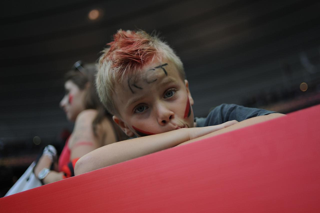 A young supporter of Toulon looks on before the French Top 14 rugby union final match Toulouse vs Toulon, on June 9, 2011 at the Stade de France in Saint-Denis, outside Paris. Toulouse defeated Toulon 18-12.   AFP PHOTO / FRED DUFOURFRED DUFOUR/AFP/GettyImages