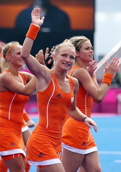 Maartje Goderie of Netherlands and herteam mates celebrate victory at the end of the Women's Pool WA Match W02 between the Netherlands and Belgium at the Hockey Centre on July 29, 2012 in London, England. (Photo by Daniel Berehulak/Getty Images)