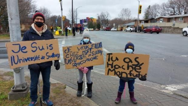 Kornel Zathureczky, an associate prof at Laurentian University, took part in Friday's rally with his daughters Justine and Eva. Zathureczky says he's fighting for continued access to French-language education in the north.