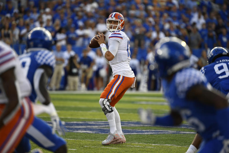 Florida quarterback Feleipe Franks (13) looks for a receiver during the first half of an NCAA college football game against Kentucky in Lexington, Ky., Saturday, Sept. 14, 2019. (AP Photo/Timothy D. Easley)
