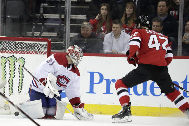 New Jersey Devils right wing Nathan Bastian (42) scores his first career goal against Montreal Canadiens goaltender Carey Price (31) during the first period of an NHL hockey game, Monday, Feb. 25, 2019, in Newark, N.J. (AP Photo/Julio Cortez)