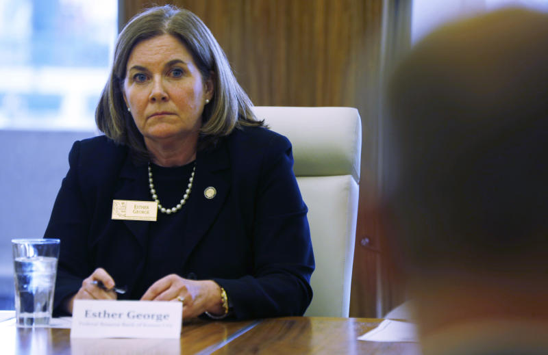 Esther George, left, president of the Kansas City Federal Reserve Bank, listens to a speaker during a closed door meeting with representatives of the marijuana industry in Colorado, Thursday, April 9, 2015, in Denver. Kansas City Federal Reserve President George held the closed door meeting with 20 representatives of the marijuana industry at the behest of Colorado congressmen Ed Perlmutter and Jared Polis. (AP Photo/David Zalubowski)