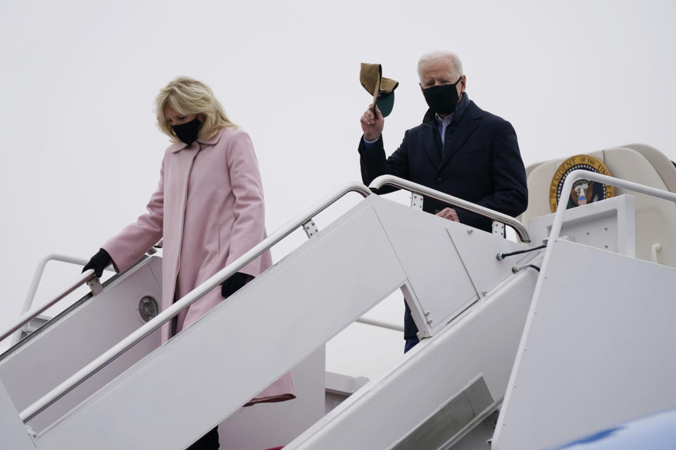 President Joe Biden and first lady Jill Biden arrive at Andrews Air Force Base after spending the weekend at Camp David, Monday, Feb. 15, 2021, in Andrews Air Force Base, Md. (AP Photo/Evan Vucci)