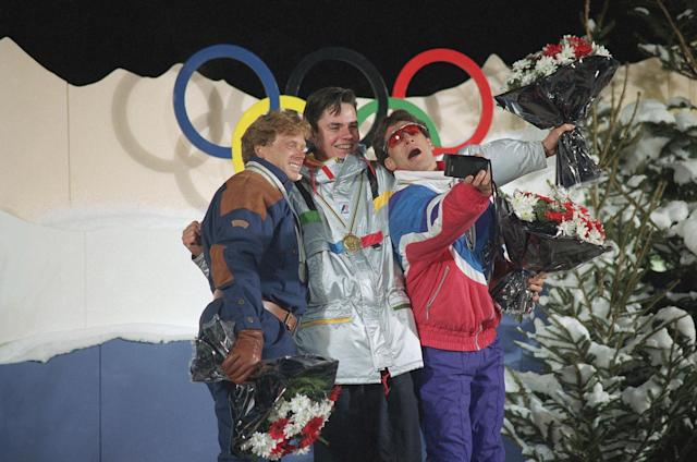<p>Third-placed Lane Spina, right, takes a picture of winner Fabrice Becker of France, center, and second-placed Norway's Rune Kristiansen after they received awards for a demonstration of men's freestyle ballet skiing at the '92 Winter Olympics in Tignes, France. (AP) </p>