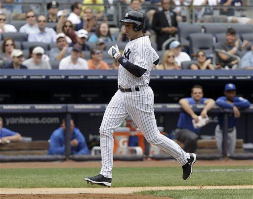 New York Yankees' Derek Jeter runs toward home plate on a Vernon Wells sacrifice fly during the first inning of a baseball game against the Kansas City Royals at Yankee Stadium, Thursday, July 11, 2013 in New York. (AP Photo/Seth Wenig)