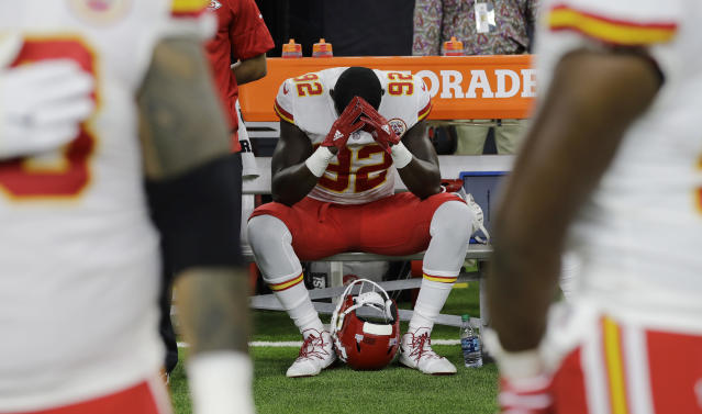 "FILE - In this Oct. 8, 2017, file photo, Kansas City Chiefs linebacker Tanoh Kpassagnon (92) sits on the bench during the national anthem before an NFL football game against the Houston Texans, in Houston. NFL owners have approved a new policy aimed at addressing the firestorm over national anthem protests, permitting players to stay in the locker room during the ""The Star-Spangled Banner"" but requiring them to stand if they come to the field. The decision was announced Wednesday, May 23, 2018, by NFL Commissioner Roger Goodell during the league's spring meeting in Atlanta.(AP Photo/David J. Phillip, File)"