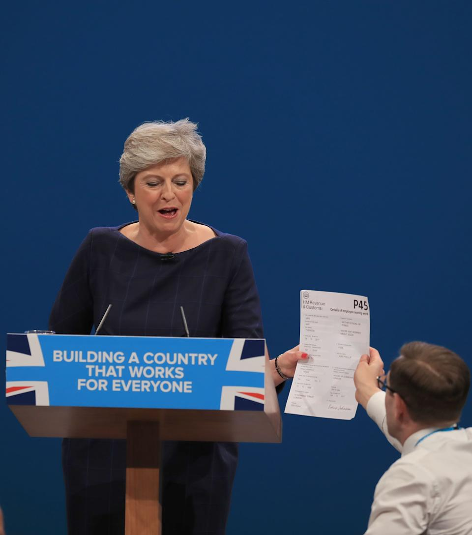 Memorable moment when comedian Simon Brodkin, also known as Lee Nelson handed Prime Minister Theresa May a P45 form during her keynote speech at the Conservative Party Conference. Perhaps she should have taken the hint then. Photo dated 04/10/17 (PA)