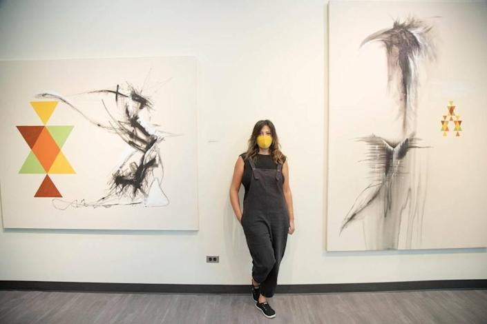 Iraqi-born artist Luma Jasim is pictured with her work in the exhibit Long Term Vision, open from Aug. 22 to Oct. 3 at Boise State's Student Union Building Fine Arts Gallery.