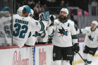 San Jose Sharks defenseman Brent Burns celebrates with the bench after scoring a goal against the Minnesota Wild during the first period of an NHL hockey game Saturday, April 17, 2021, in St. Paul, Minn. (AP Photo/Craig Lassig)