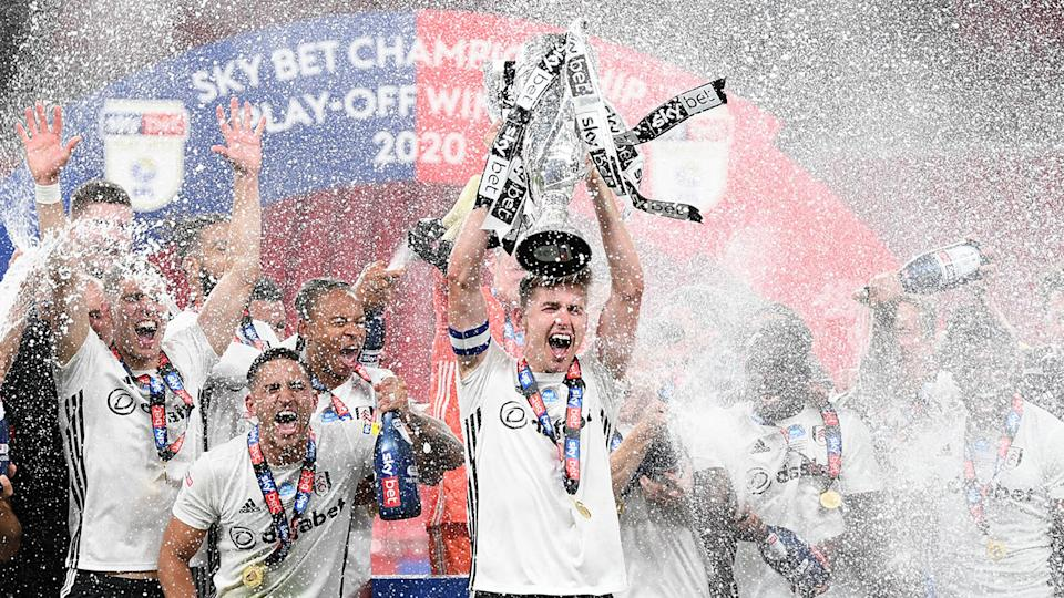 Fulham players are seen celebrating their Championship play-off final win against Brentford.