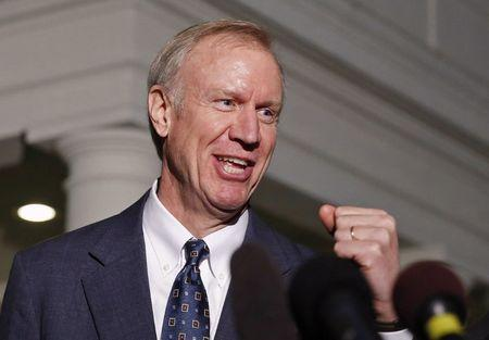 FILE PHOTO - Bruce Rauner talks to media after meeting with Obama at the White House in Washington