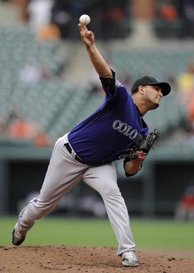 Colorado Rockies starting pitcher Jhoulys Chacin delivers against the Baltimore Orioles during the first inning of a baseball game on Sunday, Aug. 18, 2013, in Baltimore. (AP Photo/Nick Wass)