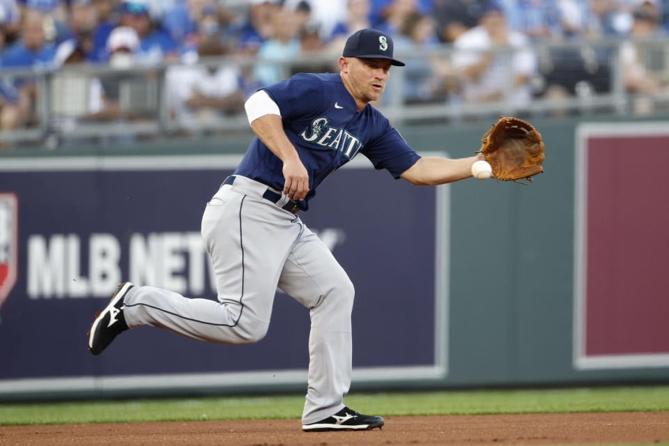 Seattle Mariners third baseman Kyle Seager fields a ground ball hit by Kansas City Royals' Whit Merrifield during the first inning of a baseball game at Kauffman Stadium in Kansas City, Mo., Saturday, Sept. 18, 2021. Merrifield singled on the play. (AP Photo/Colin E. Braley)