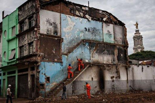 Workers demolish an abandoned building where drug addicts used to live, as part of the city's cleanup project of the area known as 'Cracolandia' (Crackland, in English), in downtown Sao Paulo, Brazil. A muscular police operation to evict drug users from central Sao Paulo is triggering howls of protest from rights groups who say the crackdown's aim is to sanitize the area for developers