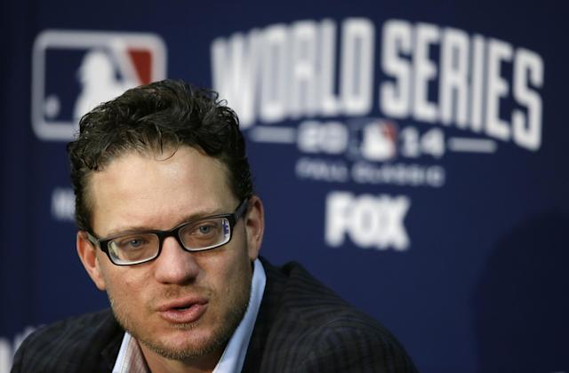 FILE - In this Oct. 27, 2014, file photo, San Francisco Giants pitcher Jake Peavy speaks during a news conference in Kansas City. A person familiar with the negotiations says pitcher Jake Peavy has agreed to a $24 million, two-year contract to stay with the World Series champion San Francisco Giants. The person spoke on condition of anonymity to The Associated Press on Friday, Dec. 19, 2014, because the agreement had not yet been announced. (AP Photo/Charlie Neibergall, File)