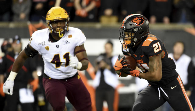 Oregon State running back Artavis Pierce runs with the ball as Arizona State defensive lineman Tyler Johnson closes in during the first half of an NCAA college football game in Corvallis, Ore., Saturday, Nov. 16, 2019. (AP Photo/Steve Dykes)