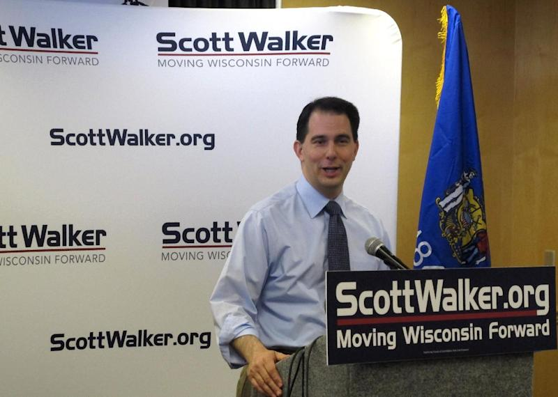 """Wisconsin Gov. Scott Walker speaks during a news conference at the Wisconsin Republican Party convention in Green Bay, Wis., on Friday, May 11, 2012. Newly released documentary film footage shows the embattled govenor shortly after his election describing a """"divide and conquer"""" strategy for taking on unions by first going after public employees' collective bargaining rights. Walker said Friday that he has no desire to pursue right-to-work legislation and no such bill would pass the Legislature under his watch. (AP Photo/Scott Bauer)"""