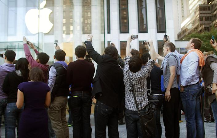 """Like the versions before it, the iPhone 5—""""the thinnest, lightest, fastest iPhone"""" since, well, the last one—drove plenty of obsession among Apple fans. Preorders of the iPhone 5 sold out in an hour. (Mario Tama/Getty Images)"""