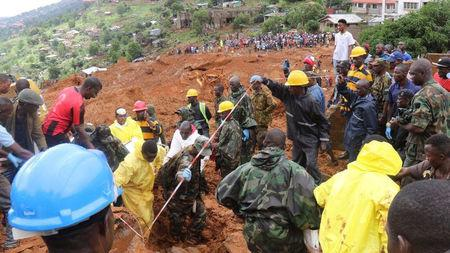 QUALITY REPEAT: Rescue workers search for survivors after a mudslide in the Mountain town of Regent, Sierra Leone