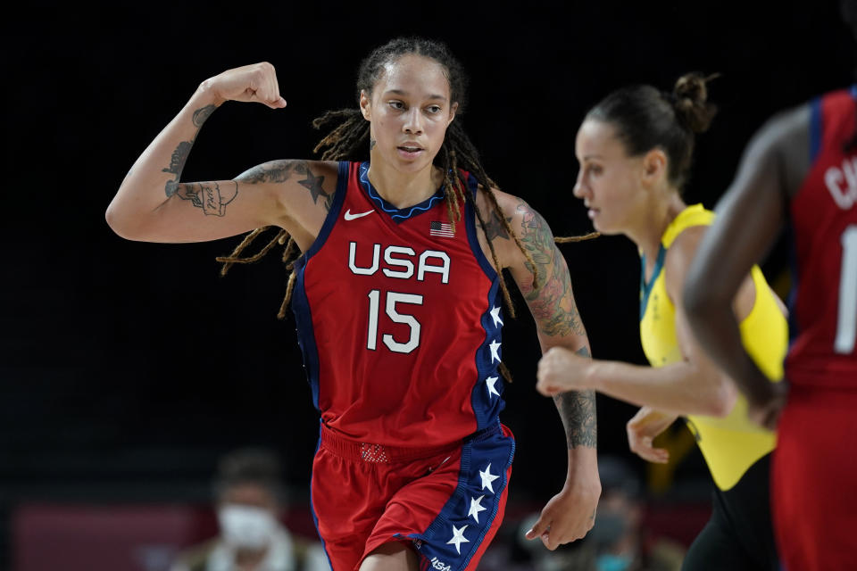 United States's Brittney Griner (15) flexes her muscle after making a basket during a women's basketball quarterfinal round game against Australia at the 2020 Summer Olympics, Wednesday, Aug. 4, 2021, in Saitama, Japan. (AP Photo/Charlie Neibergall)
