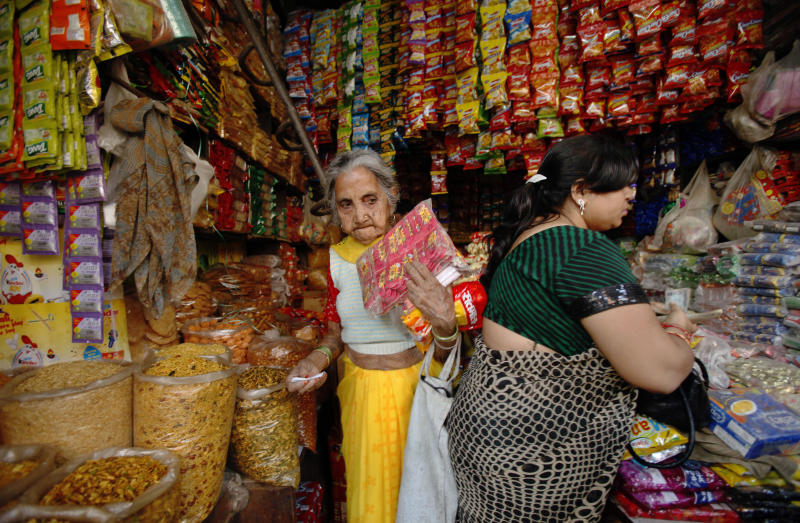 Indian women shop at a store in New Delhi, India, Friday, Nov. 25, 2011.  Indian Commerce Minister Anand Sharma told reporters that the Indian cabinet's decision late Thursday allowing 51 percent foreign ownership of supermarkets would vastly improve decrepit infrastructure that causes massive food waste in a country plagued by malnutrition and high inflation. (AP Photo/Gurinder Osan)