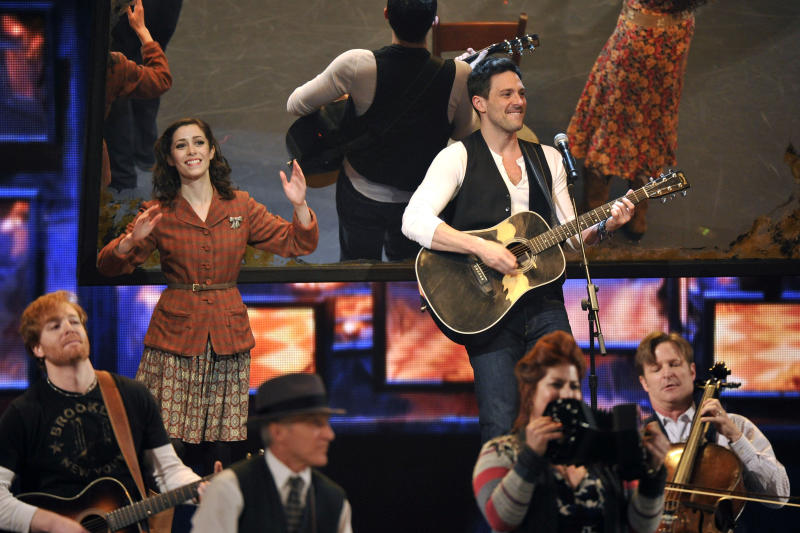 """Cristin Milioti, left, and Steve Kazee perform in a scene from """"Once"""" at the 66th Annual Tony Awards on Sunday June 10, 2012, in New York. (Photo by Charles Sykes /Invision/AP)"""