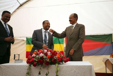 Eritrea's President, Isaias Afwerki receives a key from Ethiopia's Prime Minister, Abiy Ahmed during the Inauguration ceremony marking the reopening of the Eritrean Embassy in Addis Ababa