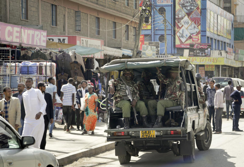 Kenyan police make a routine patrol in the Eastleigh area of the capital Nairobi, Kenya, Friday, Jan. 18, 2019. Extremists stormed a luxury hotel complex in Kenya's capital on Tuesday, setting off explosions and gunning down people at cafe tables in an attack claimed by militant group al-Shabab. (AP Photo/Khalil Senosi)