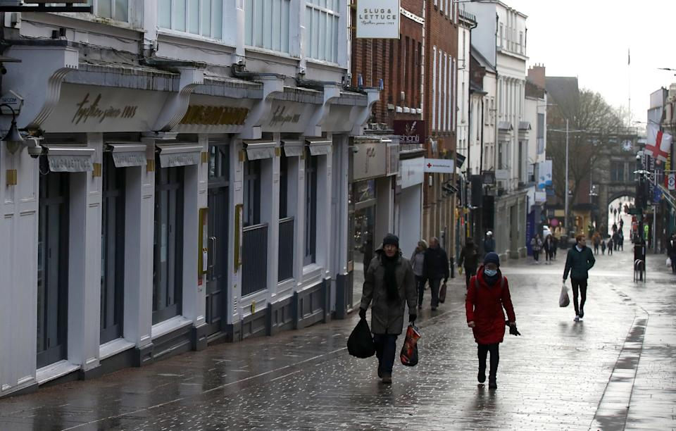 Shoppers walk past closed shops in Lincoln city centre during England's third national lockdown to curb the spread of coronavirus. Under increased measures people can no longer leave their home without a reasonable excuse and schools must shut for most pupils. (Photo by Tim Goode/PA Images via Getty Images)
