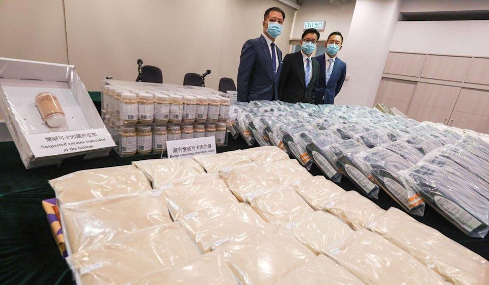 Customs Divisional Commander Philip Chan (left) poses with seized drugs, including about 72kg of cocaine, at a press conference in July. Photo: Nora Tam