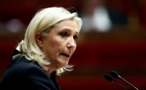 FILE PHOTO: Marine Le Pen, member of parliament and leader of French far-right National Rally (Rassemblement National) party, delivers a speech during a debate on migration at the National Assembly in Paris