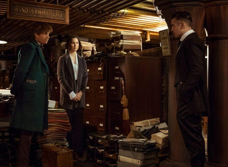 Newt Scamander (Eddie Redmayne) and Tina Goldstein (Katherine Waterston) get scolded by Percival Graves (Colin Farrell) at MACUSA HQ (Photo: Warner Bros.)