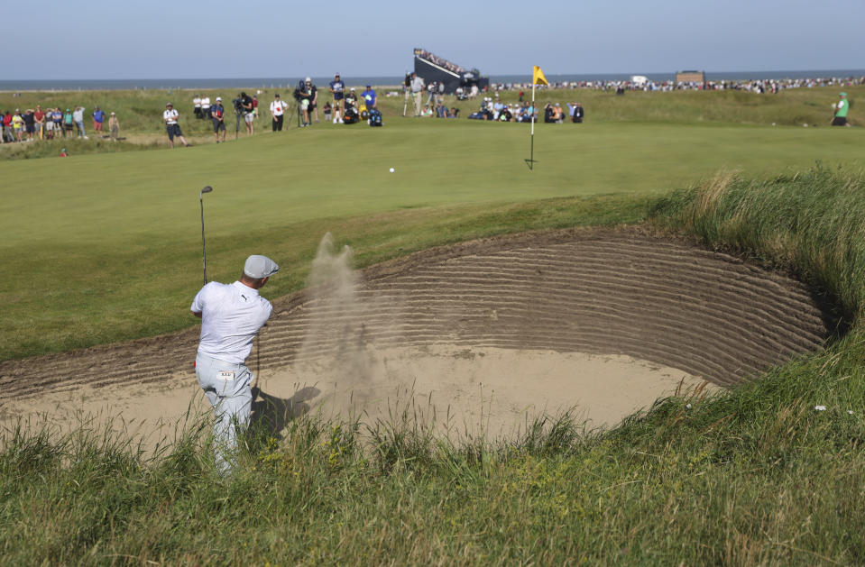 United States' Bryson DeChambeau plays out of a bunker on the 10th green during the second round of the British Open Golf Championship at Royal St George's golf course Sandwich, England, Friday, July 16, 2021. (AP Photo/Peter Morrison)