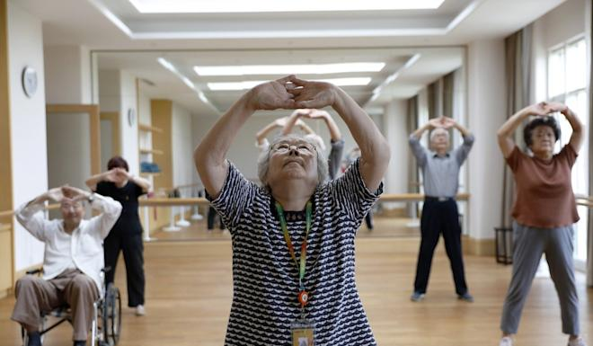 Residents practice tai chi at one of Beijing's luxury retirement communities. Photo: EPA-EFE