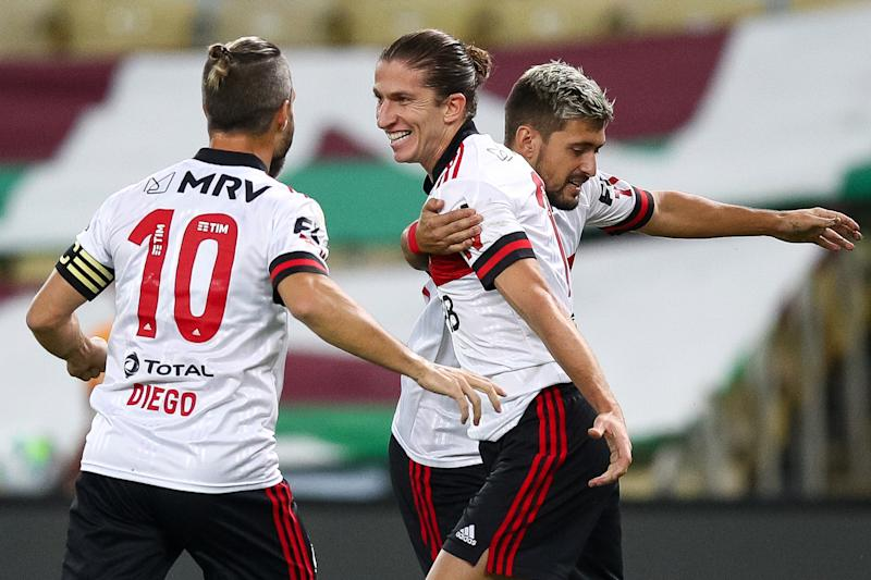 RIO DE JANEIRO, BRAZIL - SEPTEMBER 09: Filipe Luis (R) of Flamengo celebrates with his teammates after scoring his team's first goal during a match between Fluminense and Flamengo as part of 2020 Brasileirao Series A at Maracana Stadium on September 09, 2020 in Rio de Janeiro, Brazil. (Photo by Buda Mendes/Getty Images)