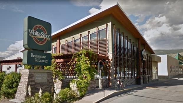 The franchisee of a White Spot restaurant in Penticton has apologized after dumping dog poop on the walkway of a neighbouring homeless shelter. (Google Streetview - image credit)