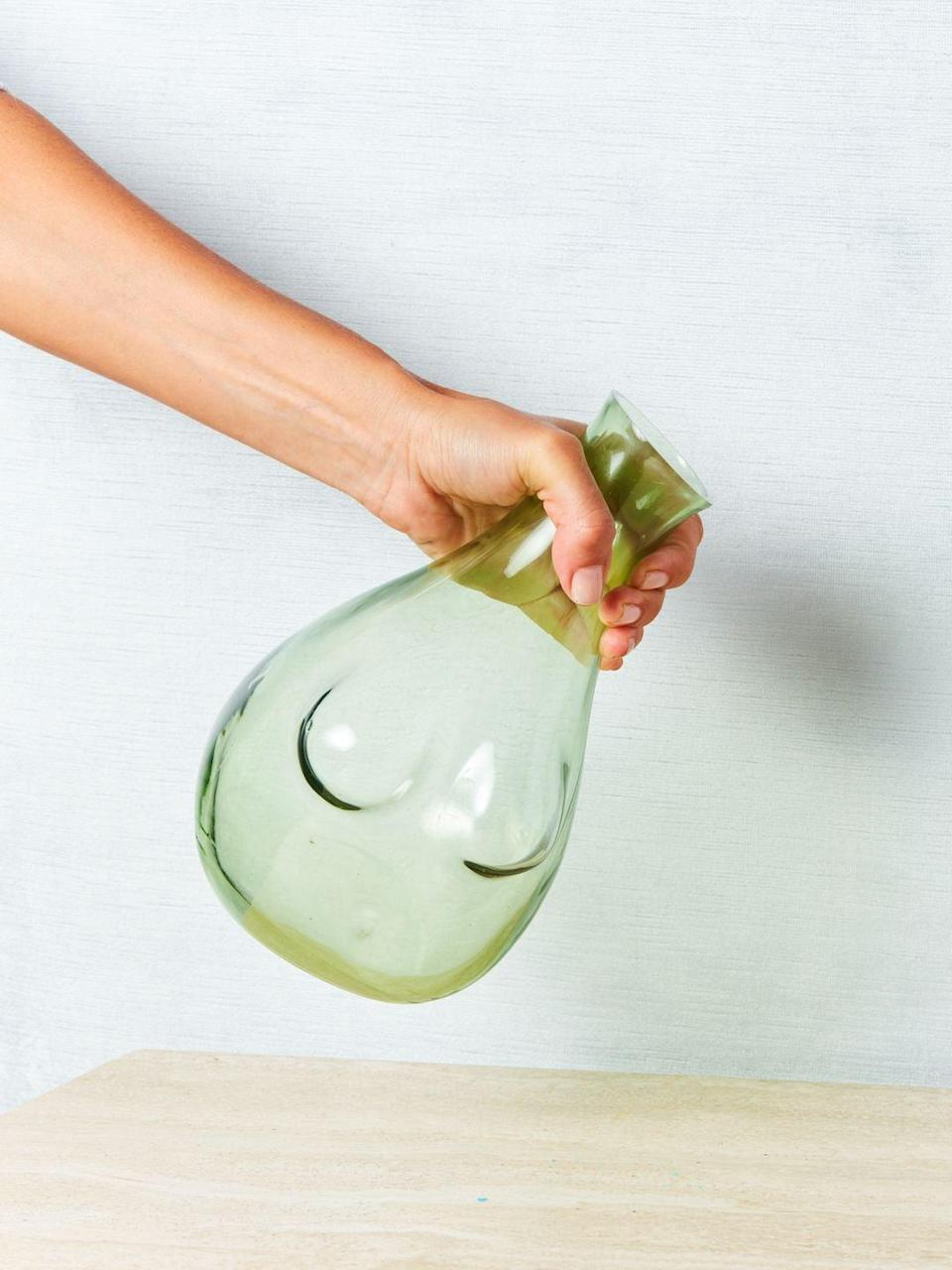"""<h2>Anna Karlin Studios Boobs Decanter</h2> <br>This one's pricey, but we couldn't resist: for a statement-making mom, these glass decanters handblown in the shape of a female torso are empowering wine-pouring perfection.<br><br><em>Shop <strong><a href=""""https://comingsoonnewyork.com/"""" rel=""""nofollow noopener"""" target=""""_blank"""" data-ylk=""""slk:Coming Soon"""" class=""""link rapid-noclick-resp"""">Coming Soon</a></strong></em><br><br><strong>Anna Karlin Studios</strong> Boobs Decanter, $, available at <a href=""""https://go.skimresources.com/?id=30283X879131&url=https%3A%2F%2Fcomingsoonnewyork.com%2Fproducts%2Fboobs-decanter"""" rel=""""nofollow noopener"""" target=""""_blank"""" data-ylk=""""slk:Coming Soon"""" class=""""link rapid-noclick-resp"""">Coming Soon</a><br><br><br>"""