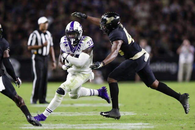 Purdue linebacker Cornel Jones, right, tries to tackle TCU running back Sewo Olonilua (33) during the first half of an NCAA college football game in West Lafayette, Ind., Saturday, Sept. 14, 2019. (AP Photo/Michael Conroy)