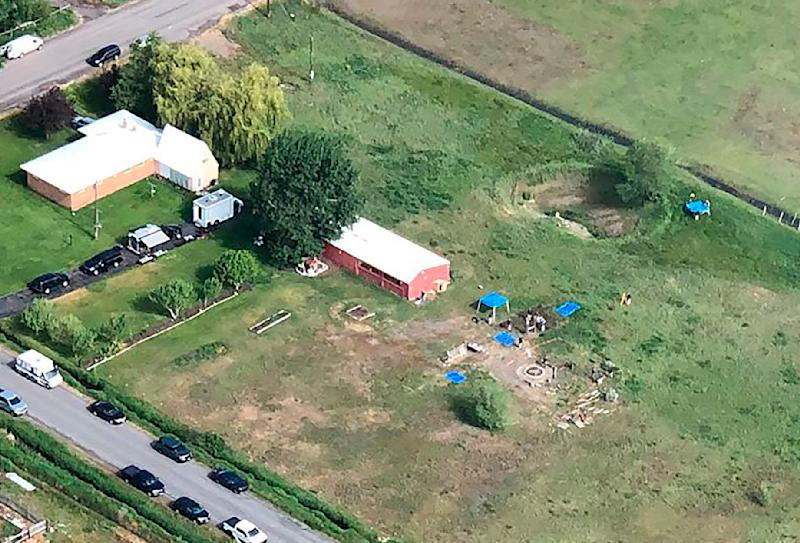CORRECTS LOCATION TO SALEM, IDAHO, INSTEAD OF REXBURG This aerial photo provided by East Idaho News shows authorities investigating a home in Salem, Idaho, on Tuesday June 9, 2020. Authorities say they uncovered human remains at an Idaho man's home as they investigated the disappearance of his new wife's two children. The case has drawn global attention for its ties to the couple's doomsday beliefs and the mysterious deaths of their former spouses. Police in the small town say Chad Daybell was taken into custody. (Nate Eaton/EastIdahoNews.com via AP)