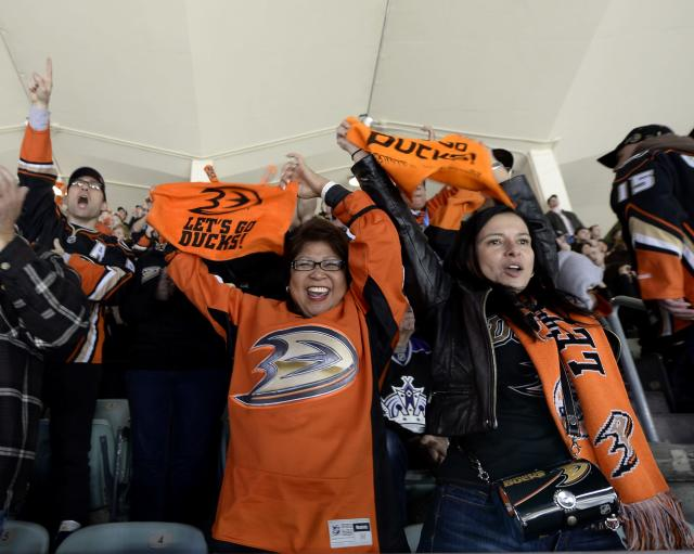 LOS ANGELES, CA - JANUARY 25: (EDITORIAL USE ONLY) Anaheim Ducks fans celebrate after a goal against Los Angeles Kings during the 2014 Coors Light Stadium Series at Dodger Stadium on January 25, 2014, in Los Angeles, California. (Photo by Kevork Djansezian/Getty Images)